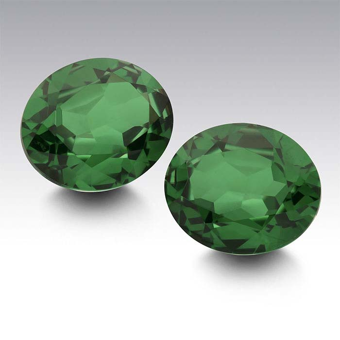 Simulated Emerald Oval Faceted Stones
