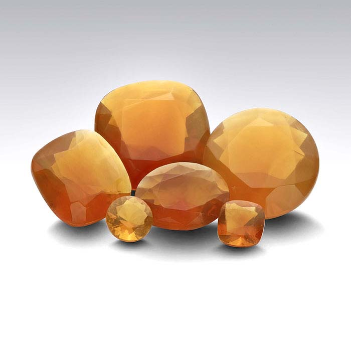 American Mined™ Lake County Fire Opal™ 12 x 10mm Oval Faceted Stone