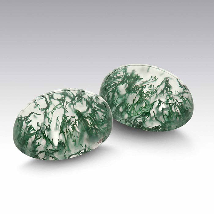 Two oval crystal quartz & moss agate doublet cabochons
