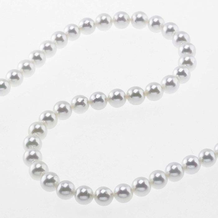 A strand of round white pearls